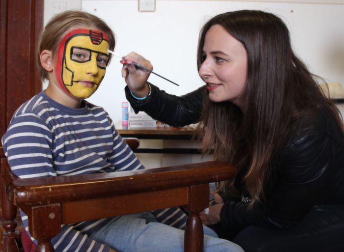 Sarah Waldron painting Colin Agner's face at the Bluebell Markets at Collis Sandes House on Saturday. Photo by Dermot Crean