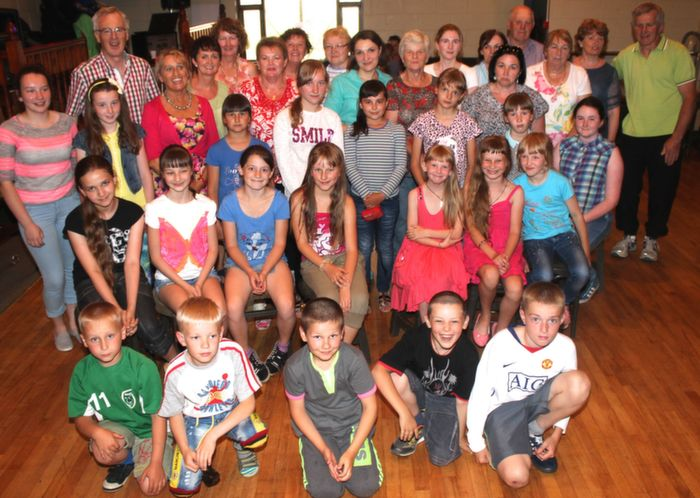 Kids along with their host families at the Chernobyl Children's Foundation in Austin Stacks clubhouse.