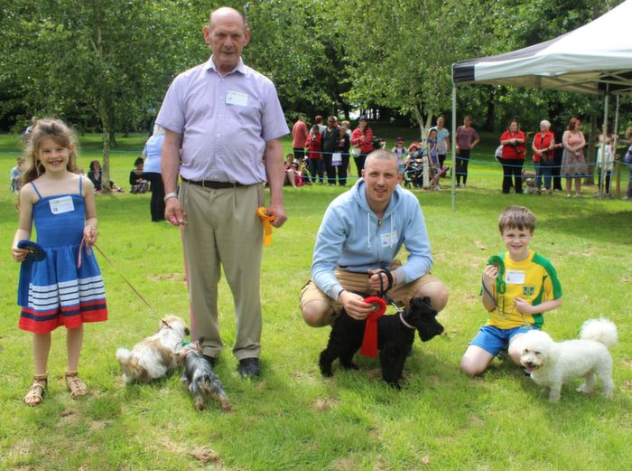 Ella Costello with Chico (2nd), Michael Hanafin with Ceri (4th), Kieran Donaghy with Bailey (1st) and Thomas Moriarty with Buddy (3rd) in the Cutest Puppy category at the Dog Show in the Town Park on Saturday. Photo by Dermot Crean
