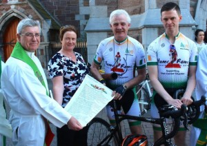 Fr Sean Hanafin with Elma and Fionnbar Walsh and Tom Foley just before the start of the journey to take Donal Walsh's anti-suicide message, written on the scroll, to Rome. Photo by Dermot Crean