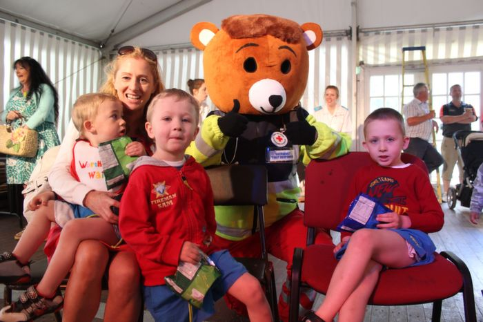 Trish Donovan with Ned, Tom and Billy, Killarney with the Red Cross Bear at the Teddy Bears Picnic at Féile na mBláth on Friday morning in the Town Park. Photo by Dermot Crean