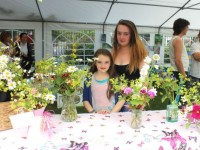 Molly and Aoife Sheehy at the Country Flowers stand at the Transition Kerry mini-village in the Town Park on Saturday. Photo by Gavin O'Connor