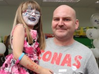 The new look Paul O'Sullivan gets the approval from daughter Erin after the headshave in aid of the A-T Society in Woodies on Saturday. Photo by Dermot Crean