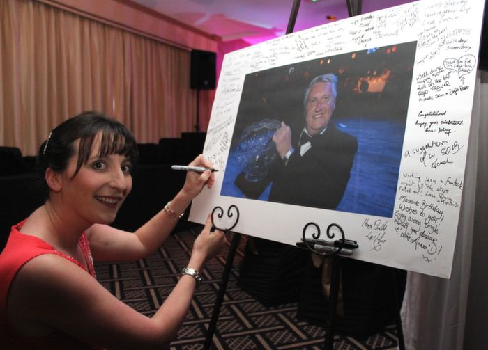 Aine Hurley signs in to Oliver Hurley's 50th birthday party at the Fels Point Hotel on Friday night. Photo by Dermot Crean