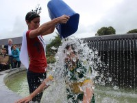 Rose of Tralee Maria Walsh dunks ice over Sen Mark Walsh in one of the Town Park fountains. Photo by Gavin O'Connor.