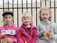 Aoife, Ciara and Maeve Trant enjoy a snack at the Boherbee residents pre-parade party on Saturday night. Photo by Ryan Higgins