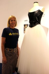 '50 Years of Fashion' curator Rebecca Kemp next to one of the dresses that will be on display in the Ashe Memorial Hall. Photo by Gavin O'Connor.