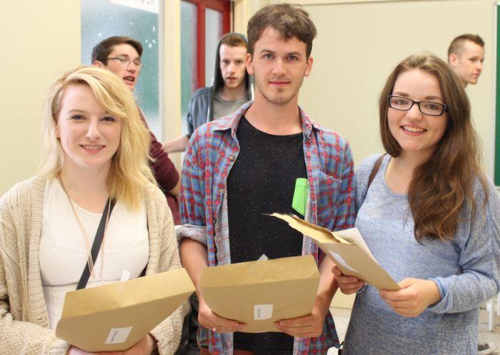 Meaghan Ní Raghlaigh, Seamus Ó Beoláin and Ruth Ní Hogáin receiving their Leaving Cert results at Gaelscoil Chiarrai on Wednesday morning. Photo by Dermot Crean