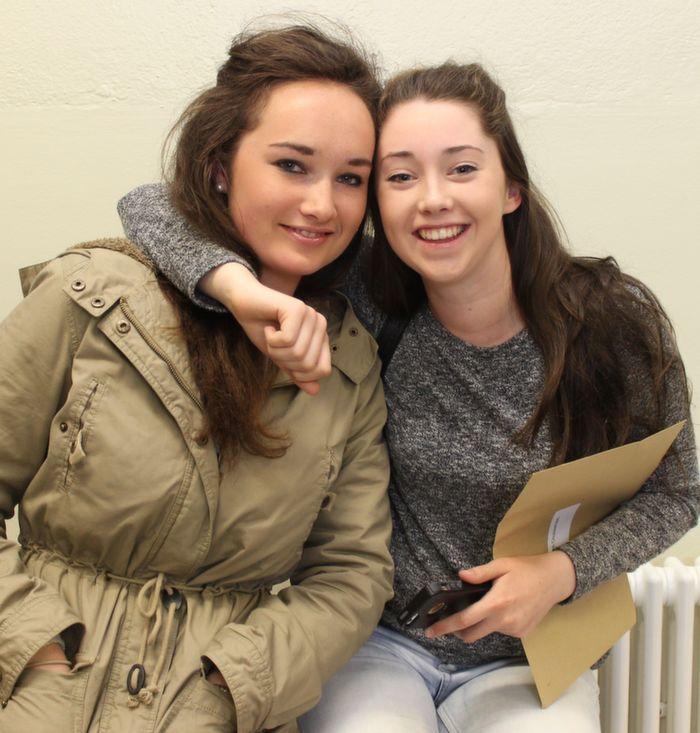 Aebhín Ní Eadhra and Eimear Ní Chuillineáin receiving their Leaving Cert results at Gaelscoil Chiarrai on Wednesday morning. Photo by Dermot Crean