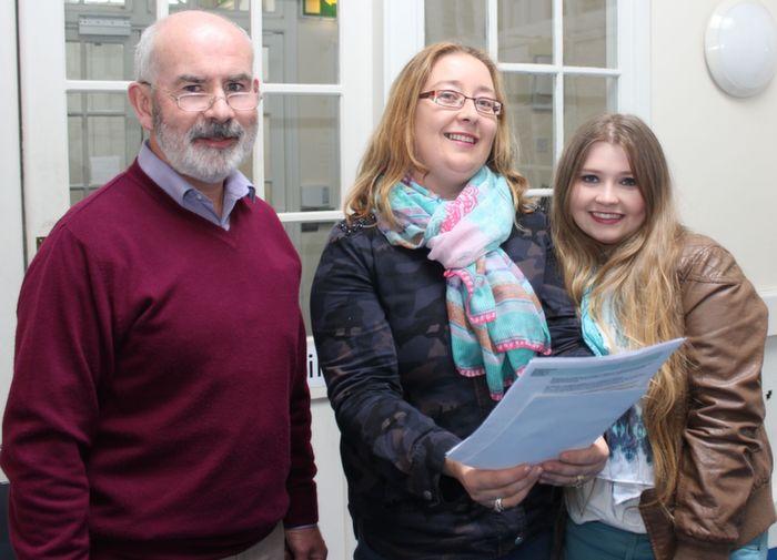 Student Laura Ashley Ní Shuilleabháin (right) with Principal of Gaelscoil Chiarraí, Austin Ó Seachnasaigh and her mother Lorraine at the school on Wednesday. Photo by Dermot Crean