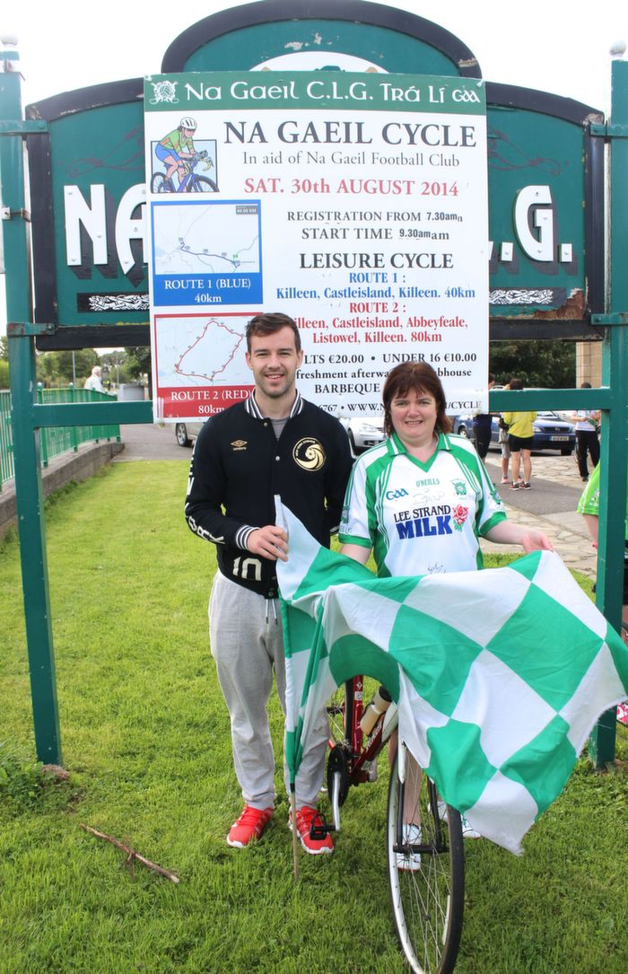 Catherine O'Connor wearing the famous World Cup autographed jersey with clubman Michael Griffin who started the Na Gaeil GAA Club fundraising cycle on Saturday morning. Photo by Dermot Crean