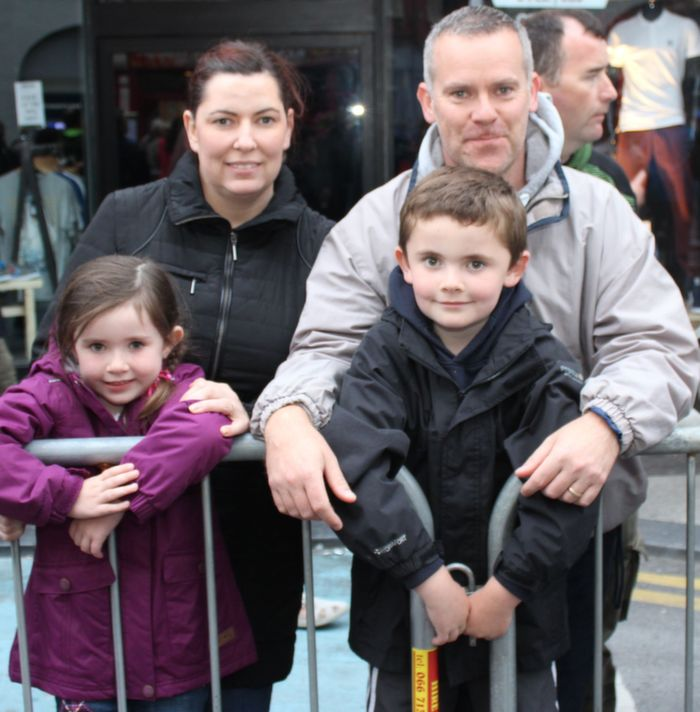Sinead and Eamon Cunningham, Abbeydorney with children Ciara and Darragh at the Rose Parade on Saturday night. Photo by Dermot Crean
