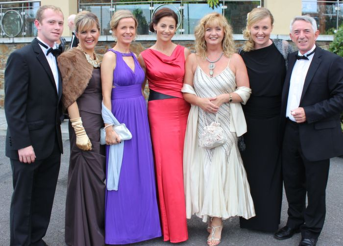 Mikey Ryle, Teresa O'Brien, Elaine Buckley, Una Lynch, Maureen Fleming, Andrea O'Donoghue and Jerry Fleming at the Rose Ball in the Dome on Friday night. Photo by Dermot Crean