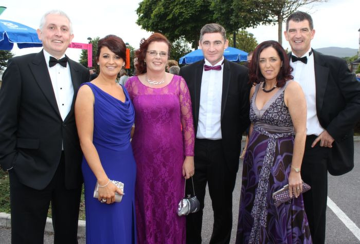 Liam and Regina Hession, Clare, David and Sharon Leavy, Westmeath and Sean and Sharon Conchuir, Galway, at the Rose Ball in The Dome on Friday night. Photo by Dermot Crean