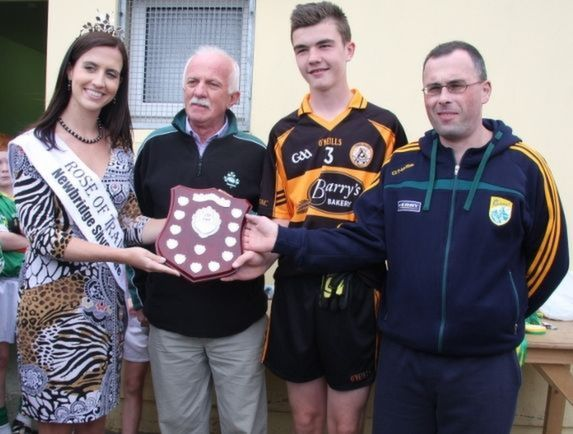 Rose of Tralee, Haley O'Sullivan, presents the Rose Shield to  Sean Quilter, captain of Austin Stacks.  Also included is Coiste Thra Li's Padraig MacAmbhlaiobh and John Slattery. Photo by Adrienne McLoughlin