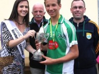 Rose of Tralee, Haley O'Sullivan, presents the Rose Cup to  Seamus Harty, captain of Na Gaeil team.  Also included is Coiste Thra Li's Padraig MacAmbhlaiobh and John Slattery. Photo by Adrienne McLoughlin