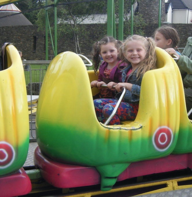 Alana Walsh and Abbie Russell enjoying a ride on the Caterpillar at Birds Amusements last year. Photo sent in by Pascal Power