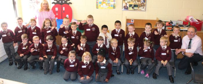Ms Moriarty's junior infants class with Principal Ed O'Brien on Thursday morning. Photo by Dermot Crean