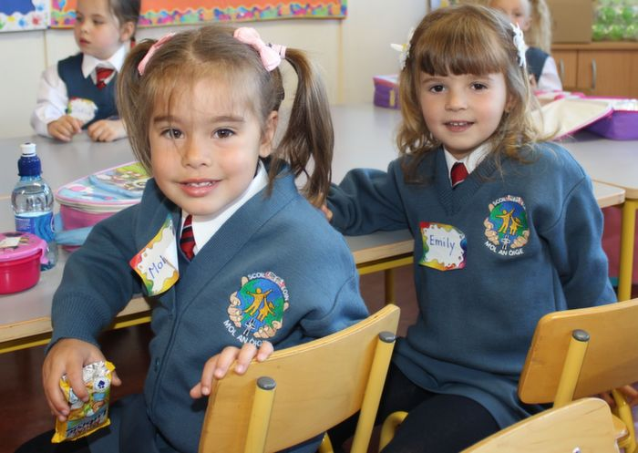 Malwina Jankowski and Emily Beqja in Scoil Eoin on their first day at school. Photo by Dermot Crean