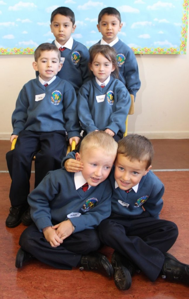 The three sets of twins in Ms Fiona Sheehan's class who started school in Scoil Eoin on Thursday morning. Standing are Eremie and Elisei Novac, seated are Billy and Tara Cashman and sitting on ground is Adam and Ryan Molloy . Photo by Dermot Crean