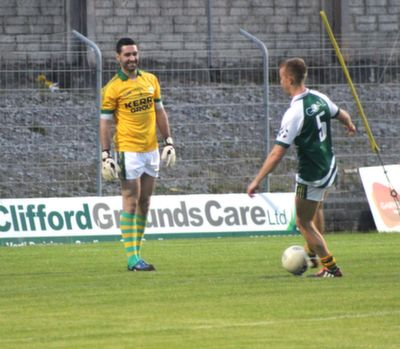 Fionn Fitzgerald cheekily kicks the ball off the tee just as Bryan Sheehan was about to take a kick out. Photo by Gavin O'Connor.