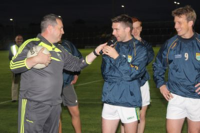 Kerry team coach, Cian O'Neil, poses the question to Marc O'Se will he be staying on another year? Marc keeps his cards firmly to his chest. Photo by Gavin O'Connor.