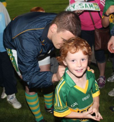 Stephan O'Brien signs the jersey of one lucky fan. Photo by Gavin O'Connor.