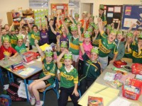 Pupils from Listellick National School show off the green and gold for their 'Jersey Day' on Friday. Photo by Gavin O'Connor.