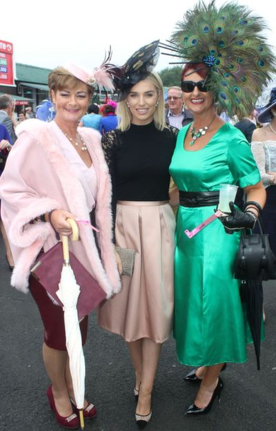 Olivia Wall, Tralee, Judge in the Best Dressed Lady competition Pippa Ormond O'Connor and Ann Kahraman, Ballyheigue,  enjoying Ladies Day at Listowel Races on Friday. Photo by Dermot Crean