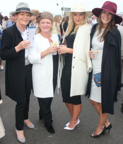 Christine Kelly, Newcastlewest, Margaret and Maeve Dalton, Athea, and Charlie Horner, London,  enjoying Ladies Day at Listowel Races on Friday. Photo by Dermot Crean