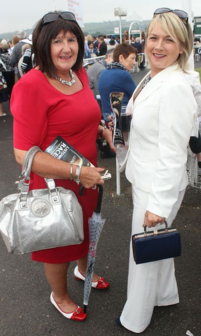 Eileen McQuinn and Mags O'Halloran enjoying Ladies Day at Listowel Races on Friday. Photo by Dermot Crean