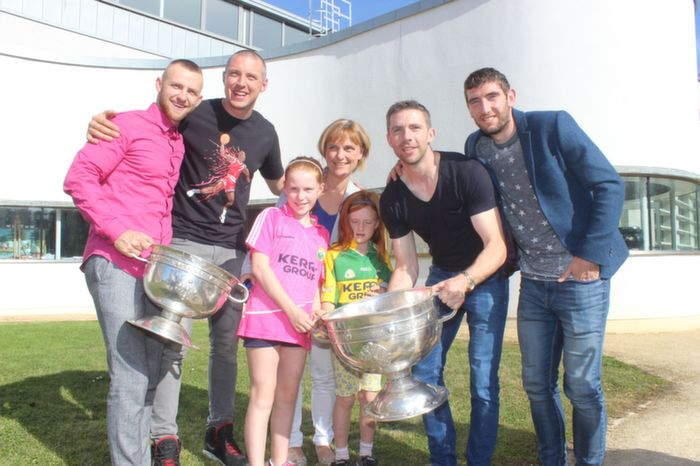 Fans pose with Sam Maguire and Kerry players, Barry John Walsh, Kieran Donaghy, Marc O'Se and Killian Young. Photo by Gavin O'Connor.