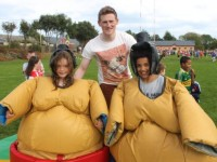 Liam O'Sullivan with two young participants in the sumo wrestling at the St Pat's GAA Club Family Fun Day on Sunday. Photo by Dermot Crean