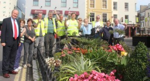 Marking Tralee's retention of their Tidy Towns Gold Medal at Denny Street on Tuesday afternoon were Mayor of Tralee, Jim Finucane with Tralee Tidy Towns Kit Ryan, Anne Connolly, Tommy McDonnell, Richard Moloney, Pat Galvin, Terry Nammock, Josephine Griffin, Mary O'Brien, Danny Moynihan, Brendan Murphy and John Griffin, Tourism Officer with Kerry County Council. Photo by Dermot Crean