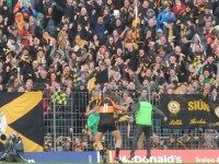 Shane Carroll and Stephen Stack, celebrate, Kieran Donaghy's, goal with fans last Sunday. Photo by Oscar Brophy.