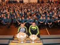 Barry John Keane with Sam Maguire cup and Andrew Barry with the Tom Markham Cup, along with students of Mercy Mounthawk. Photo by Gavin O'Connor. Photo by Gavin O'Connor