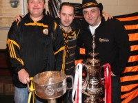 Kevin Healy, Jonathan Lynch and Paul O'Connor with the Bishop Moynihan Cup and the FA Cup at the Austin Stacks Clubhouse on Sunday morning. Photo by Dermot Crean