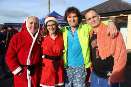 Mike and Deirdre O'Halloran with Alan and Francis Fitzgibbon before the Christmas Day Swim in Fenit. Photo by Dermot Crean