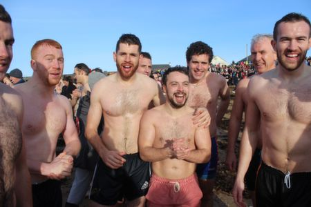 Tralee lads after the first dash into the sea at the Christmas Day Swim in Fenit. Photo by Dermot Crean
