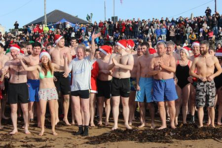 Lining up for the Christmas Day Swim in Fenit. Photo by Dermot Crean