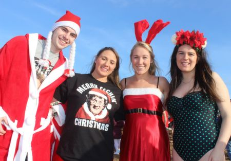 Derek O'Mahony with Joanna, Judy and Sarah Kate Walsh at the Christmas Day Swim in Fenit. Photo by Dermot Crean