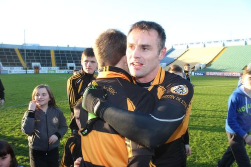 A fan congratulates William Kirby after the game. Photo by Dermot Crean