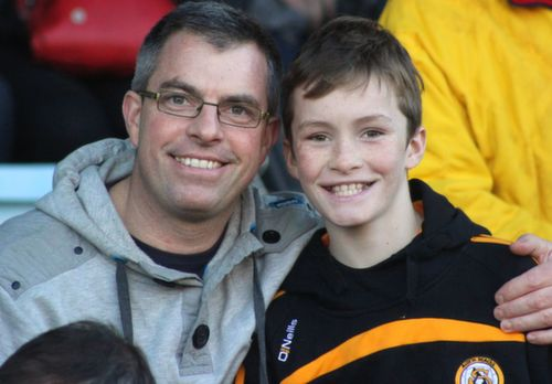 Jimmy and Cillian Litchfield during the half-time break at Pairc Ui Chaoimh on Sunday. Photo by Dermot Crean