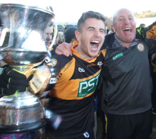 David and Ger Mannix celebrate with the new addition to the trophy cabinet at Connolly Park. Photo by Dermot Crean