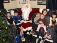 Daniel Kirby, Ben Murphy, Billy Kirby, Grace Kirby, Kate Kirby and Cara Kirby meet Santa at the Tralee Rugby Club Christmas Family Day on Saturday. Photo by Dermot Crean