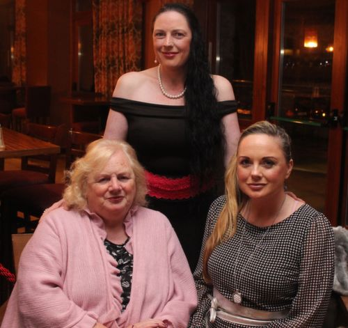 Standing: Carol Heffernan with Noreen and Sharon Heffernan at the Fels Point Hotel Women's Christmas Celebration. Photo by Dermot Crean