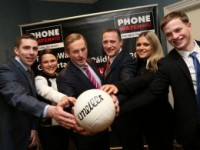 Taoiseach Enda Kenny with Phone Watch's MD Eoin Dunne (centre) join Paidi O'Se's children L-R Marc O' Se,Neasa O Se,Siun O'Se and Paidi Og O Se at the launch of the 26th PhoneWatch Comortas Peile Páidí Ó Sé 2015.
