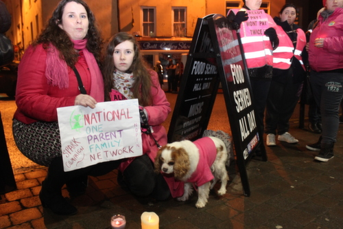 Protesting Joan Burton's arrival were Orla and Emily Evans. Photo by Gavin O'Connor.