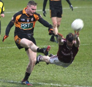 Greg Horan shoots for a score in the second half. Photo by Dermot Crean.