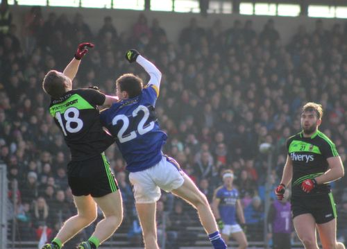 Colm Boyle of Mayo and Philip O'Connor of Kerry tussle rise for the ball watched by Aidan O'Shea of Mayo during the Allianz League game between Kerry and Mayo at Killarney on Sunday. Photo by Dermot Crean